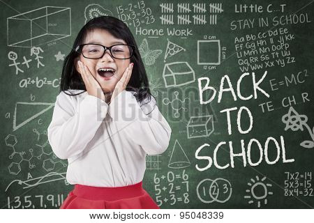 Funny Little Girl In Classroom