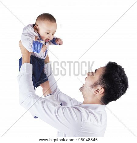 Happy Dad Holds And Lift Up His Baby