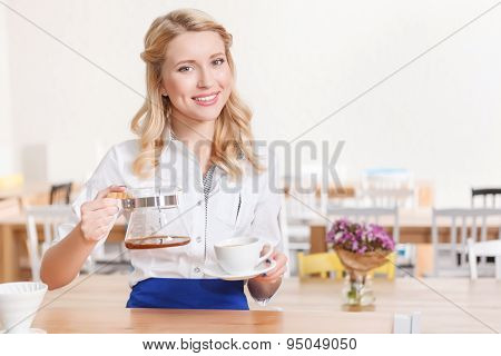 Pretty smiling waitress in cafeteria
