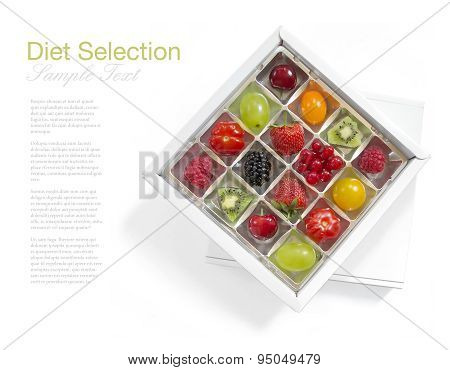 different fresh fruits in a chocolate box