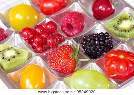 Fresh fruits in a chocolate box
