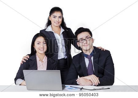Three Businesspeople Looking At The Camera Isolated
