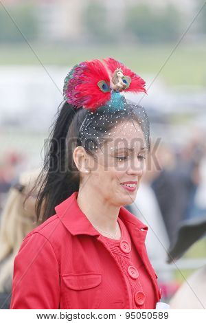 Whoman In Red Dress At The Hat Parade