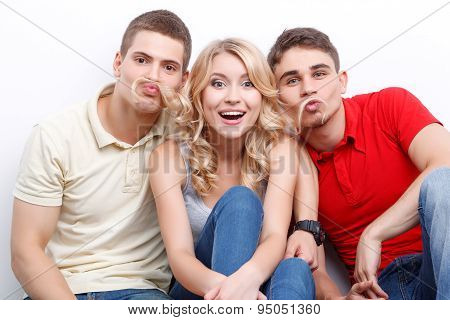 Three friends wiggling on isolated background