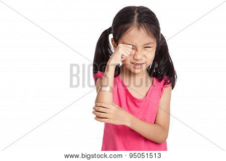 Little Asian Girl  Hurt With Bandage On Her Arm