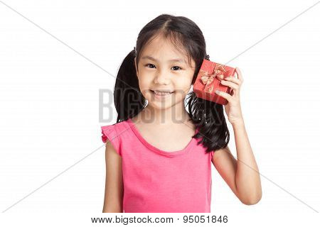 Happy Little Asian Girl With Red Gift Box