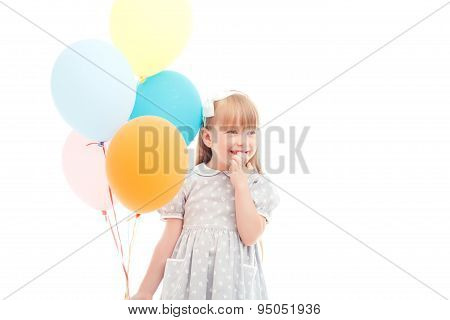 Pleasant girl holding balloons
