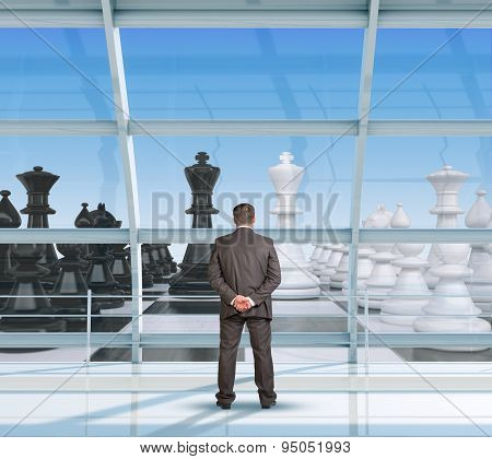 Businessman looking at chess