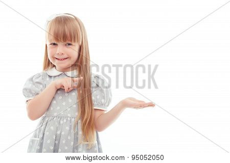 Surprised little girl pointing left