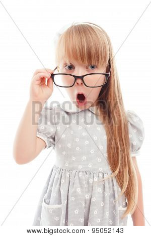 Pleasant little girl wearing glasses