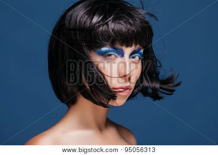Closeup portrait of beautiful woman with bob hairstyle. Fashion model face With creative makeup