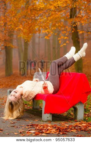 Girl Relaxing In Autumn Park Having Fun