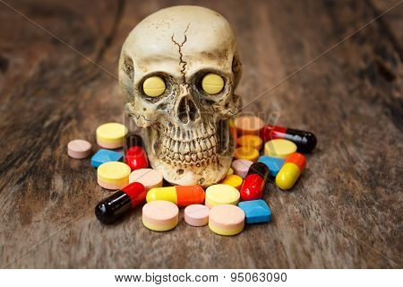 Human Skull In The Pile Of Drugs.