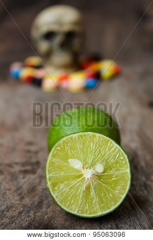 Lemon And Human Skull In The Pile Of Drugs.