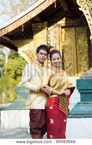 young boy and young girl in Laos national costume