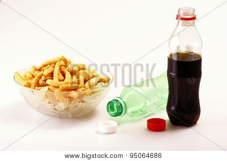 Bottles of softdrinks or soda, chips