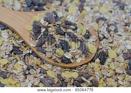 Oat Flakes In Wooden Spoon On Oat Flakes Background