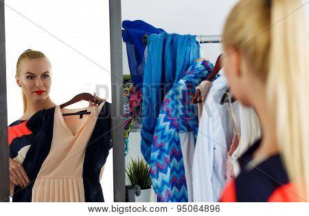 Reflection Of Beautiful Blonde Woman Trying New Dress