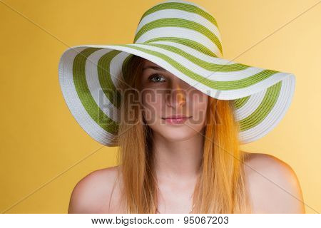 young pretty girl with a hat on her head. horizontal