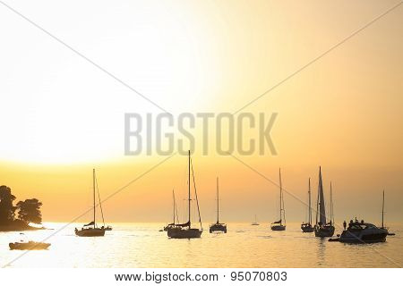 Sailboats Anchored At Sunset In Adriatic Sea