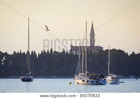 Sailboats In Front Of Saint Eufemia Church