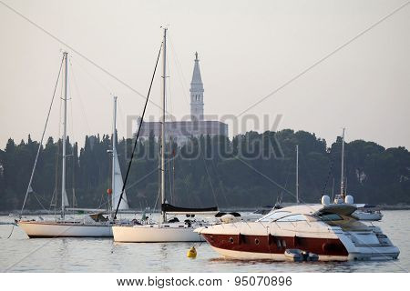 Saint Euphemia Bell Tower And Anchored Sailboats