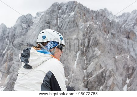 Alpinst looking at mountain wall.