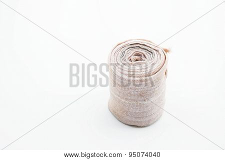 Old used bandage roll on white background