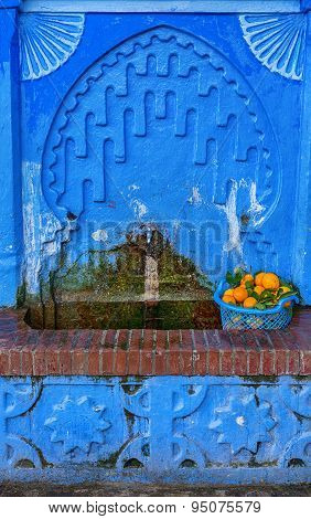 Blue oriental drinking fountain.