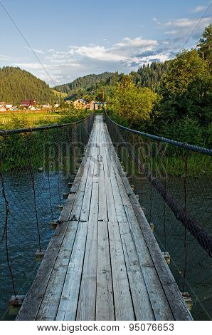 Suspension Bridge Over The River In The Mountains