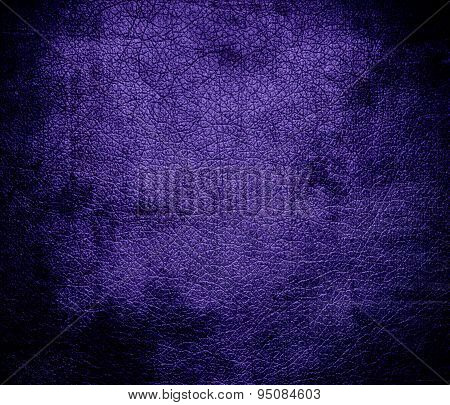 Grunge background of blue-magenta violet leather texture
