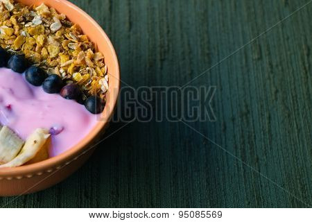 Bowl Of Muesli On A Green Table.