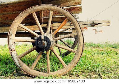 Wheel Of Old Wooden Cart Taken Closeup.
