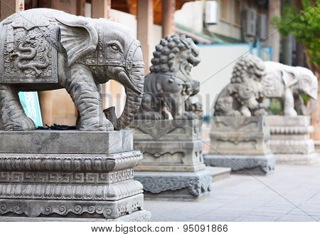 Stone sculptures of the holly animals. Entrance to the South Putuo (Nanputuo) temple