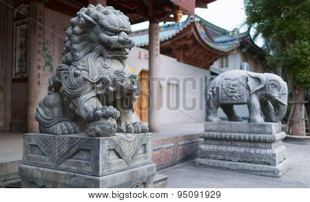 Stone sculptures of the holly animals. Entrance to the South Putuo temple