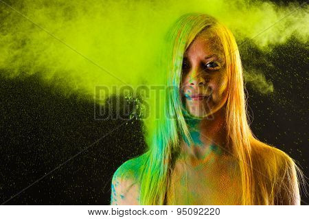 attractive woman in green colors Holi