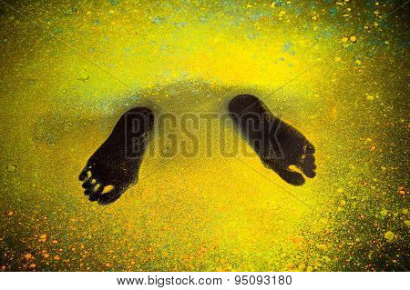 traces of human feet in the paint Holi