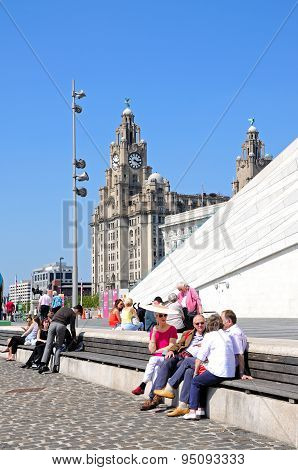 Tourists and the Royal Liver building, Liverpool.