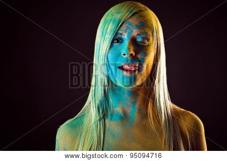 beautiful seductive woman in blue colors Holi licking lips