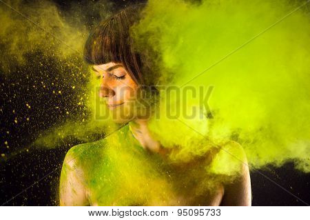 beautiful brunette in a green paint Holi