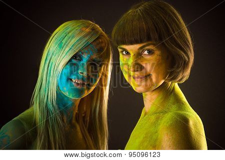 two beautiful woman in colors Holi