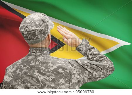 Soldier In Hat Facing National Flag Series - Guyana