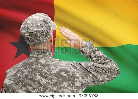 Soldier In Hat Facing National Flag Series - Guinea-bissau
