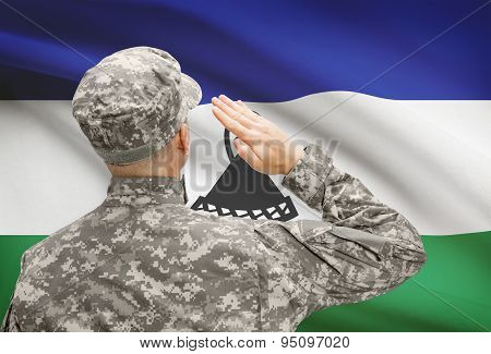 Soldier In Hat Facing National Flag Series - Lesotho