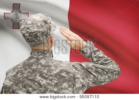 Soldier In Hat Facing National Flag Series - Malta