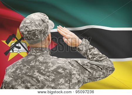 Soldier In Hat Facing National Flag Series - Mozambique