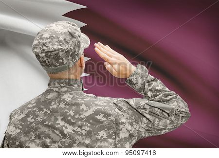 Soldier In Hat Facing National Flag Series - Qatar