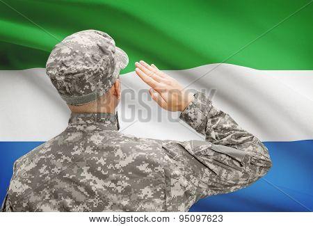 Soldier In Hat Facing National Flag Series - Sierra Leone