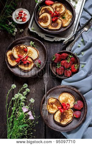 Pancakes With Wild Berries On Dark Wooden Table.