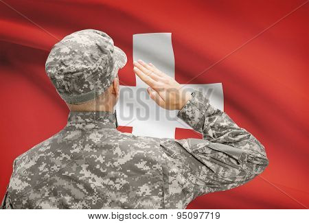 Soldier In Hat Facing National Flag Series - Switzerland